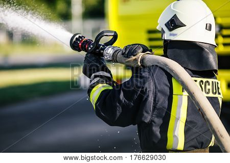 fireman drills water spill combustion zone in training