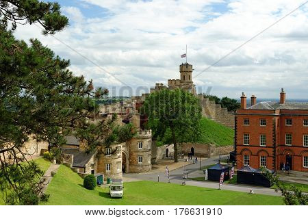 Lincoln Uk - July 1 2016: The Observatory Tower And The Stone Gatehouse East Gate Entrance To Lincol