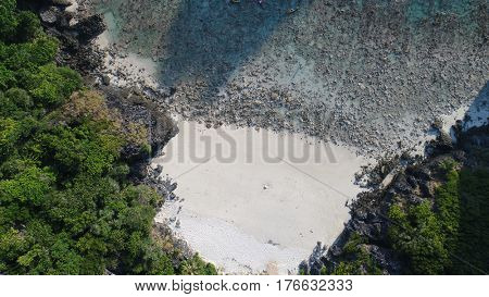Aerial drone photo top view of Nui Bay beach, part of iconic tropical Phi Phi island, Thailand