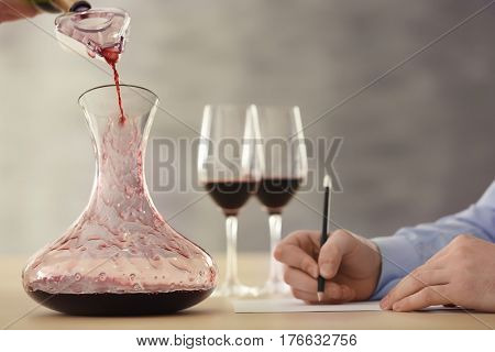 Sommelier estimating red wine at tasting
