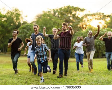Group of diversity people active running together