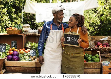 Greengrocer selling organic fresh agricultural product at farmer market