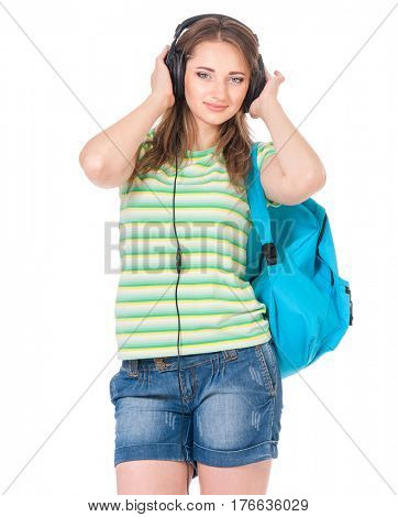 Beautiful student girl with backpack and black headphones, isolated on white background