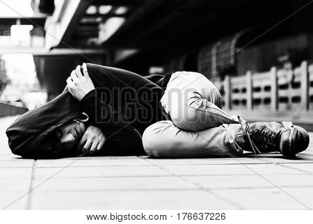 Young man homeless sleep on the street