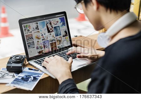 Young man photographer using digital laptop lifestyle