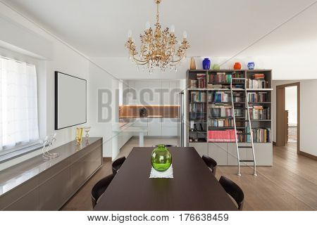 Dining table in the foreground, interior of apartment