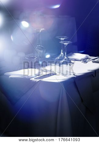 Stylish restaurant table with glasses and cutlery waiting for guests