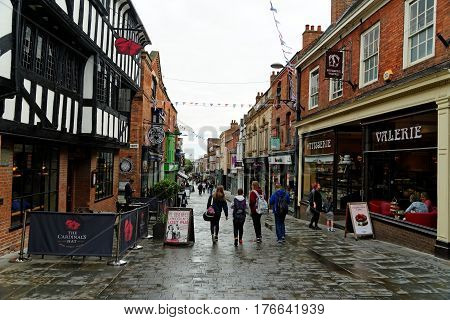 Lincoln Uk - July 1 2016: Shoppers On Lincoln High Street Looking Towards Stonebow Gate On A Rainy D