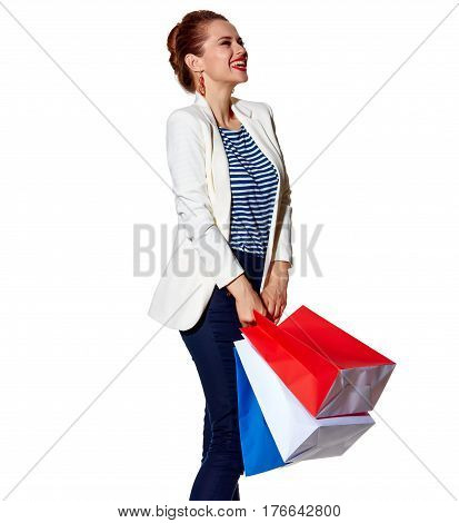 Woman With Shopping Bags On White Background Looking Aside