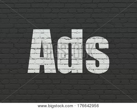Marketing concept: Painted white text Ads on Black Brick wall background