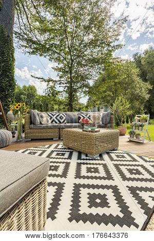 New style villa patio with pattern carpet and rattan furniture set