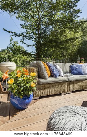 Patio With Rattan Sofa During Summer