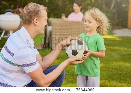 Father And Child Holding Ball