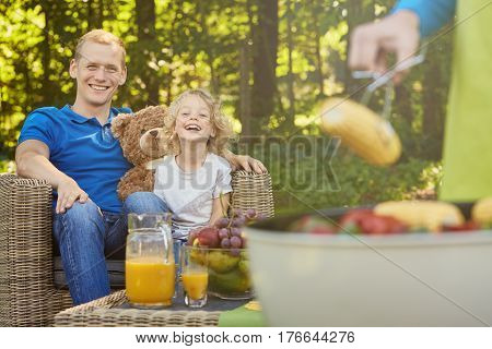 Father And Son Having Barbecue