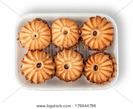 Shortbread biscuits with filling in plastic tray top view isolated on white background
