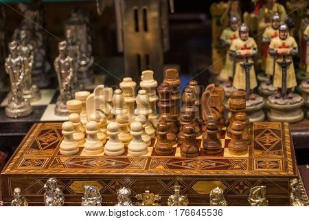 Chess board with chess wooden pieces on a background