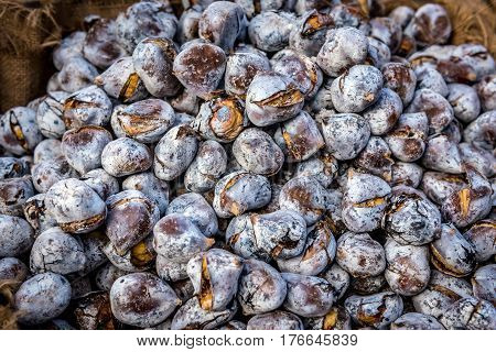 Edible chestnuts - popular street food in Porto Portugal