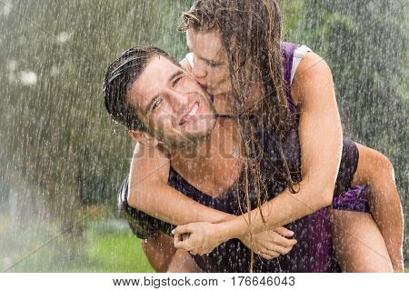 Couple Playing In The Rain
