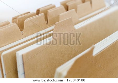 Close up of plain brown index card system dividers left blank to provide copy space.