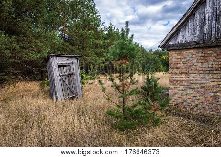 Small privy in deserted Masheve settlement Chernobyl Exclusion Zone Ukraine