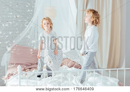Brothers Standing On Bed