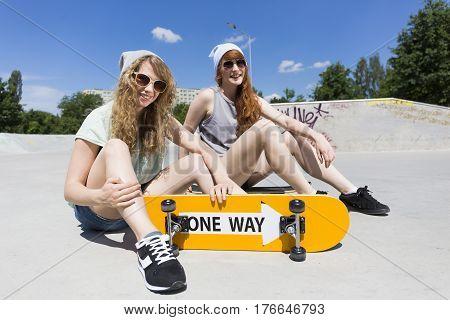 Girls Sitting On The Vert Ramp With Skateboard