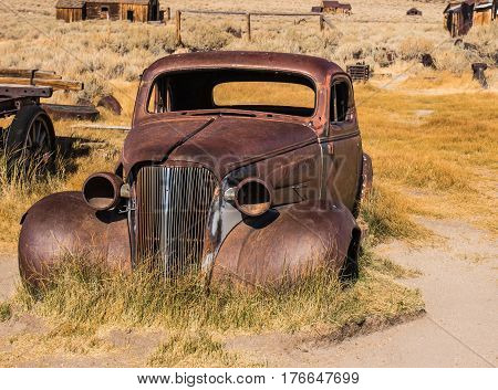 Rusted Old Shell Of Abandoned Auto In California Ghost Town