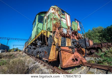 Rusty locomotive on deserted Yaniv railroad station near Pripyat city in Chernobyl Exclusion Zone Ukraine