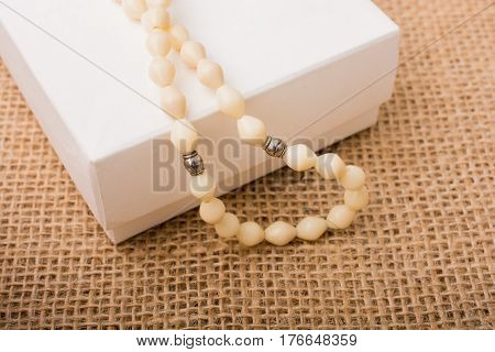 Praying beads of white color on a box