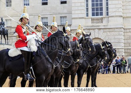 LONDON, GREAT BRITAIN - SEPTEMBER 19, 2014: This is a detachment of equestrian royal guardsmen built to change the guard at the Horse Guards.