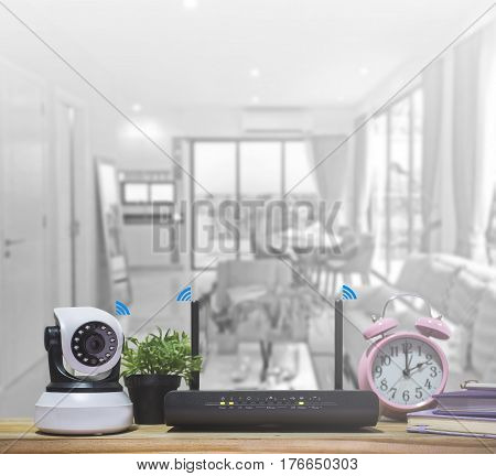 IP Camera and wireless router Security camera on Wood table.
