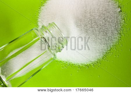 salt shaker on green
