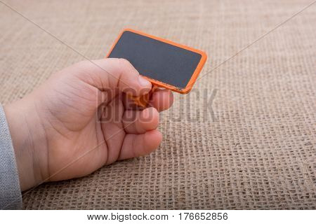 Hand holding a noticeboard on white background