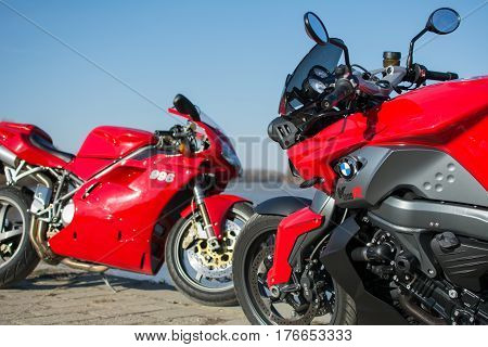 Senta Serbia: March 4th 2017. Closeup of beautiful red Ducati 996s and BMW K1300R motorcycles photographed outdoor on a dock in Senta besides beautiful river Tisa