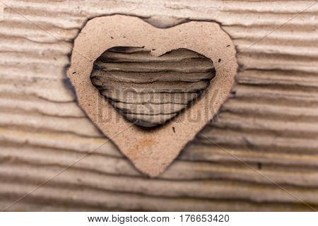 Heart Shaped Burnt Out Of A Cardboard