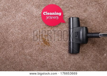 Vacuuming carpet with vacuum cleaner. Cleaning services speech bubble. Dirt on the rug. Housework service. Close up of the head of a sweeper cleaning device.