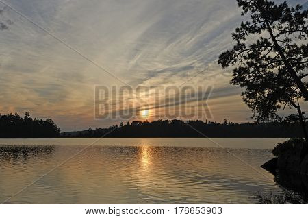 Sun and Silhouettes in Canoe Country on Saganaga Lake in Quetico Provincial Park in Ontario