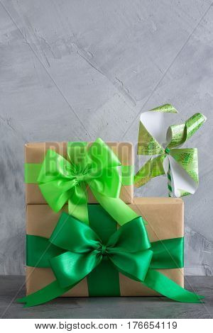 Gift Box With Green Bow On Grey Concrete Background