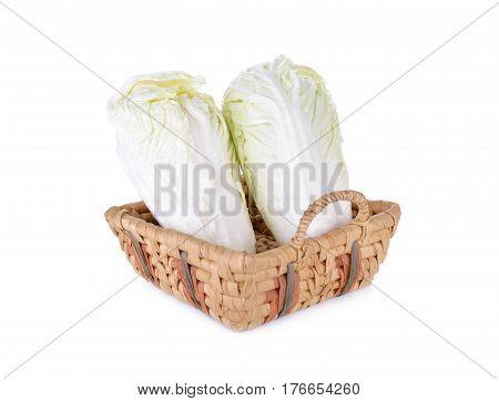 fresh napa cabbage in basket on white background