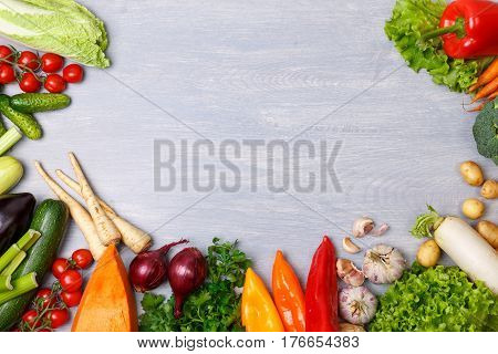 Vegetables. Tomato, cucumber and carrot. Celery, zucchini and eggplant. Potatoes, onion and garlic. Pepper, brocoli and salad, squash. Pumpkin and parsley. Organic food on wooden table.