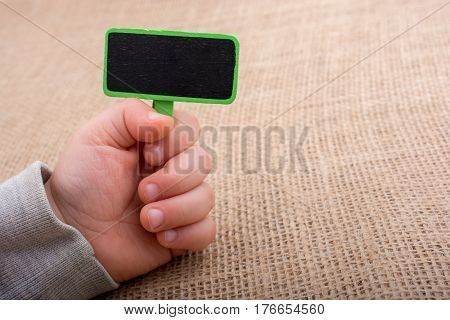 Hand holding a noticeboard on a canvas background