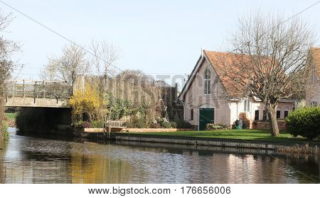 13TH MARCH 2017, CHICHESTER CANAL, SUSSEX, ENGLAND: A scenic view of the Chichester canal with housing on the waters edge in Chichester, sussex,England on the 13th march 2017