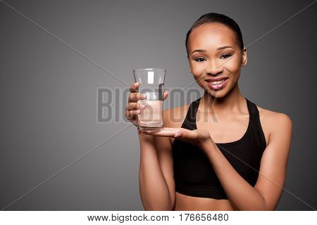 Happy Healthy Black Asian Woman With Water