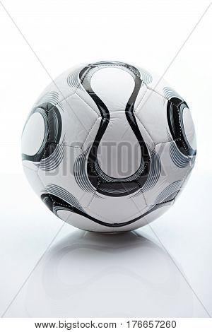 Football ball isolated on white background. Simple soccer ball with reflection