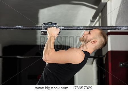 Close-up Of An Athlete Man Doing Narrow Grip Pullup Exercise In The Gym