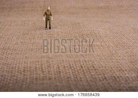 A man figurine on a brown backgorund