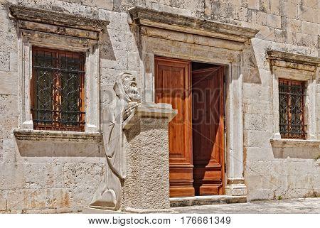 Sculpture of Renaissance playwright and poet Hanibal Lucic (Lučić) in front of the Benedictine monastery in Hvar, Croatia