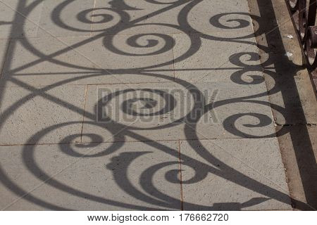 shadows of beautiful ornate balustrade - baluster