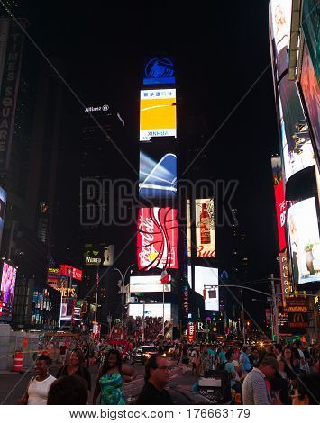 Large Crowd Of People In Times Square At Night.