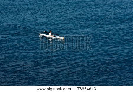 Lahaina Maui -- March 13 2017 -- Lone Kayaker paddling in the Pacific off the coast of Lahaina Maui. Editorial Use Only.